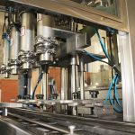 चिकनाई तेल भरने की मशीन